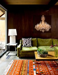 Cement floor condo made cozy with a Moroccan Kilim rug and a green velvet sofa. A large painting on the wall behind the sofa gives the illusion of a big chandelier. Style At Home, My Living Room, Living Spaces, Casa Park, Colorful Couch, Green Velvet Sofa, Green Couches, My New Room, Interior Inspiration