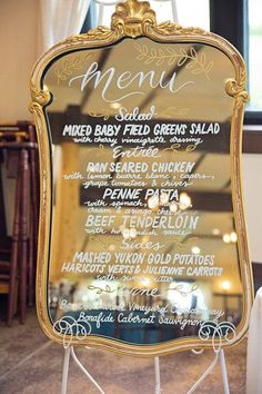 Wedding reception dinner menu displayed on vintage mirror - elegant hand-lettering on vintage mirror {Willow Noavi Photography}