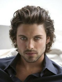 Stylish looking medium to long curly mens hairstyle