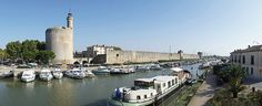 Aigues-Mortes, France. Went here in 2004, lots of mosquitoes biting, but what a stunning walled city. History on every corner and the Camargue is full of white horses too. Go see it all.