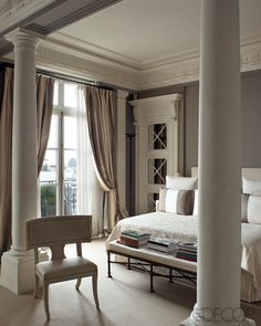 /\§/\ : Frédéric Méchiche : A pair of Tuscan columns and an 18th-century Swedish klismos chair in a bedroom.