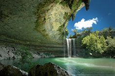 Yes, this is in Texas. Hamilton pool, located 30 miles outside of downtown Austin, is a natural pool that was created when the dome of an underground river collapsed from erosion thousands of years ago. The result is secluded pool surrounded by cliffs and huge slabs of limestone, into which a waterfall runs. Getting to the pool requires a steep quarter-mile downhill hike – but it's more than worth it.