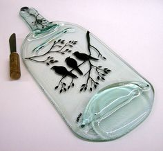 1.5 liter wine bottle has been recycled into a beautiful serving tray. The bird pattern was handpainted with food safe glass enamel and fused into the bottle. by CChilds on ety
