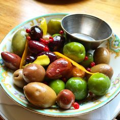 """Brooklyn Winery's plate of assorted olives are not just delicious, but also unique. Marinated in Citrus Brine, Pink Peppercorn and Sherry Vinegar, these will leave you whispering """"Olive you"""""""