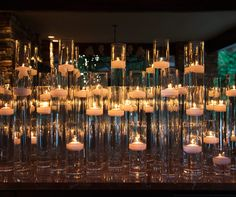 Varying sizes of hurricanes offer a visually dynamic element for wedding guests.