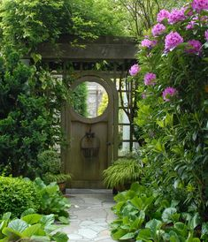 Shady, Japanese-inspired moon gate with hakonechloa, bergenia, rhododendron.