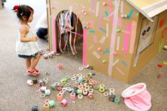 giant cardboard house with masking tape decorating