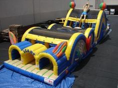 Our 3-lane obstacle course is a HUGE hit at school events because with 3 lanes you can really keep the traffic moving with this obstacle course! The kids love it, too!  www.jumpinjiminyinc.com