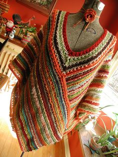 A great idea for all the leftover yarn. I would probably just make a wrap though.
