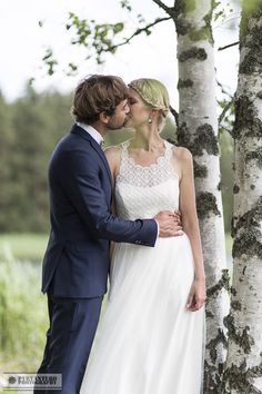 Real wedding in Finland. Dress made by Pukuni (www.pukuni.fi). Wedding dress with lace, tulle and open back.