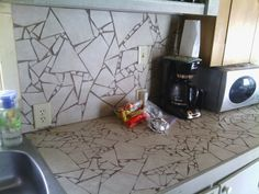Broken tile countertop.  Very easy to do and uses less tile.