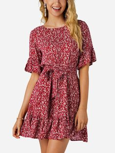 Master the moment in this pull on silhouette, scoop neck, frill details on sleeves and hemline floral dress. Available in black and red.