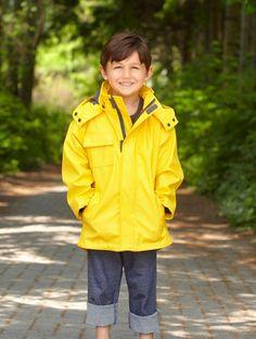 Boy wearing yellow raincoat. #welliesandworms
