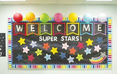 Welcome Super Stars classroom bulletin board with Fadeless Galaxy design and rainbow accents from Carson-Dellosa. p Welcome Super Stars classroom bulletin board with Fadeless Galaxy design and rainbow accents from Carson-Dellosa p Star Bulletin Boards, September Bulletin Boards, Kindergarten Bulletin Boards, Bulletin Board Design, Welcome To Kindergarten, Teacher Bulletin Boards, Welcome To School, Classroom Bulletin Boards, Preschool Classroom