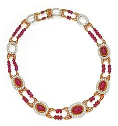Lot 146 - 18 KARAT TWO-COLOR GOLD, RUBY AND DIAMOND NECKLACE