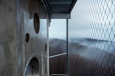nartarchitects transforms lookout tower into hiker's shelters in hungary