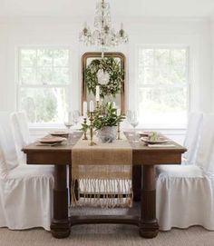 love the white ... and just the few brass candlesticks on the table.