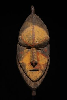 """This striking mask would have been lashed to a tall cane dance costume that would have towered six feet above the dancer's body. The mask has a powerful expression and bold colors. As one can see from the dark patinated reverse the mask has substantial age. The mask is 20 Ѕ"""" (52 cm) in height and dates to the 1920s"""