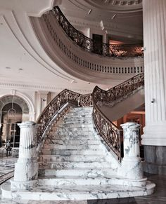 Marble staircase with wrought iron bannister. Luxury Homes