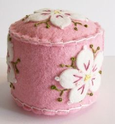 Dogwood Blossoms on Pink mini pincushion Cushions To Make, Pin Cushions, Homemade Hand Soap, Felt Pincushions, Deco Rose, Felted Wool Crafts, Felt Decorations, Penny Rugs, Felt Fabric