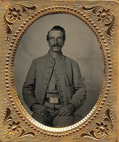 Nice sixth plate tintype of an unidentified rebel soldier. Dressed in a short grey commutation jacket with a breast pocket and matching grey trousers. It is not clear what the buttons are but, they they are not eagle buttons. He wears an eagle waist plate which, was not uncommon among Confederate troops. Nice clean image housed in a full leatherette case with a repaired spine.