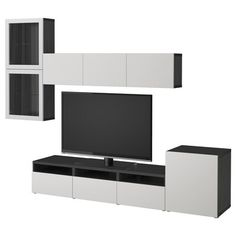 Size: cm BESTÅ TV storage combinations provide a home for your TV and storage for the gadgets you need for all the activities around it. Hide the clutter and display your favorite things in one magnificent combo! Door Shelves, Glass Shelves, Tv Storage, Storage Spaces, Record Storage, Besta Tv Bank, Glass Front Door, Glass Doors, Home