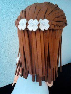 Detalle del peinado de la fofucha de Primera Comunión. Monycreque taller.