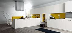 Splashes of yellow add liveliness to the contemporary kitchen