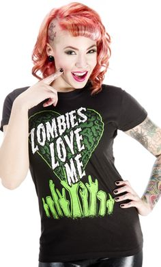 "KREEPSVILLE ZOMBIE LOVE ME TEE  - Have you got zombies clawin' at your door?! This girly tee from Kreepsville features a heart shaped brain with ""Zombies Love Me"" printed across it in white & some of your undead fans. 100% Cotton."