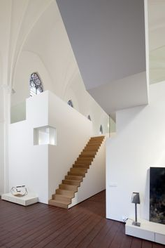 Wooden Stairs contrast and create Pattern in Otherwise White Scheme
