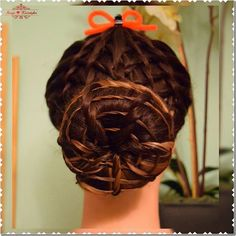 Intricate spider web bun! Such a clever hairstyle for Halloween