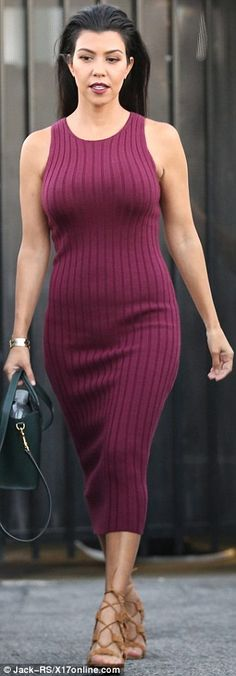 Berry nice: She showcased her relatively natural physique in the impressively tight dress on Monday