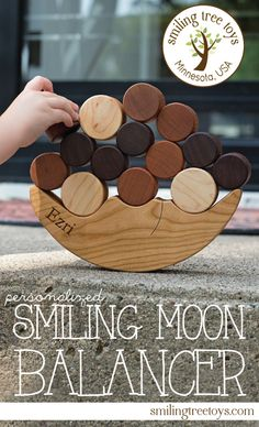 SMILING MOON BALANCER | An exciting and challenging game of balance for young and old alike. Naturally colorful solid hardwoods make this organically finished balancing toy a great learning gift for little minds. Handcrafted in Minnesota, USA. | Smiling Tree Toys