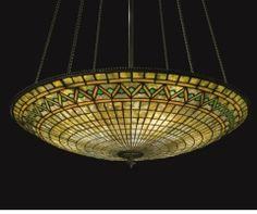 "Hanging large parasol shade with zig zag border. Tiffany Studios. Probably a 30"" + diameter shade."