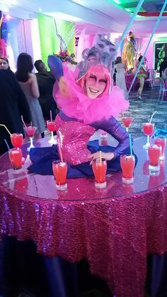 Customized pink and purple cirque table at a Quinceanera in Brownsville, TX! J&D Entertainment company based in Houston www.jdentertain.com