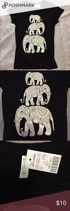 NEW ✨ Joyce Leslie Tribal Aztec Elephant T Shirt Brand new graphic shirt with tags attached. Size XL. Would also fit anyone who wears a Large. Short sleeve. Black with white graphics; elephants.                                                                            Tags: Boho, Graphic Tees, Elephants, Animals, Wild, Hippie, NWT, Tattoo, Design. Joyce Leslie Tops Tees - Short Sleeve