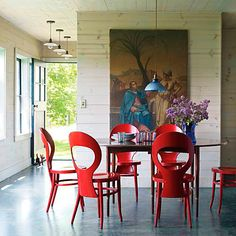 changing the color of your chairs can really modernize your dining space.  If your table is the feature, then show off the pedestal by not having too many chairs around it.  Some older Windsor chair styles work well with this look too