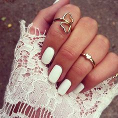 White nails. Cute rings, too!