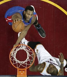 Pistons center Andre Drummond dunks past LeBron James during the second half Monday night in Cleveland.
