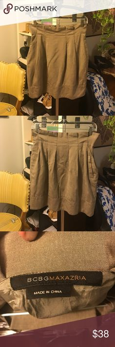 """BCBG MaxAzria beige,high waisted,skirt BCBG Max Azria beige, high waisted, skirt with two front pockets and pleating. Very lightweight and lined. Great neutral staple for your spring closet! No flaws! Waist flat cross:14.5"""", length from top of waist to hem:19"""" BCBGMaxAzria Skirts"""