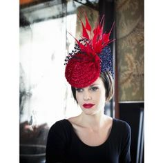 We're in love with a good headpiece and this Izziana Millinery Red number makes our head spin!!