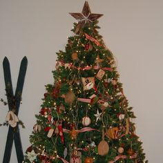 Primitive Christmas Tree.   Look closely - it has coffee grinders, rolling pins, wooden spoons and rustic stars.