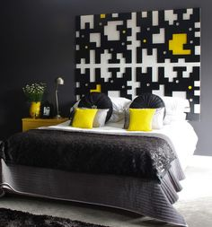 It's the striking brightness of yellow against the classically stylish black and white that creates a unique modern-classic look in this bedroom design. The accents of yellow provide a tinge of cheery contemporary feel on the otherwise traditional classy tone of circular pillows and velvety pattern beddings.  Image Credit: freshome.com
