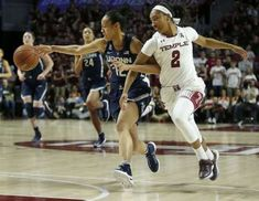 UConn guard Saniya Chong reaches for the passed basketball against Temple guard Feyonda Fitzgerald during the first quarter of an NCAA college basketball game, Wednesday, Feb. 1, 2017 in Philadelphia. Photo: Yong Kim, AP / The Philadelphia Inquirer