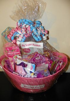 "The  ""Big Sister"" Basket. Fill a basket with girly, educational and fun products for the new or soon to be Big Sister. The basket can also be used to  help occupy the new Big Sister while visiting the new sibling in the hospital!"