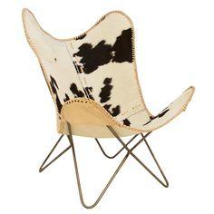 Vlinderstoel met koeienhuid is een een echte 'must-have'.De fauteuil heeft een metaal onderstel en een zitting van koeienhuid.