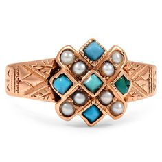 The Ashwini Ring.  This enchanting Victorian ring showcases five turquoise cabochons and ten seed pearl accents in a warm rose gold setting. Engravings on the shank complement the geometric setting for a captivating look.