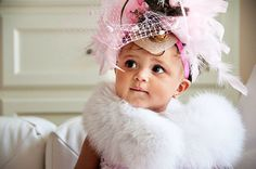 Hyrah looks stunning in her #boa and #feathers! #baby