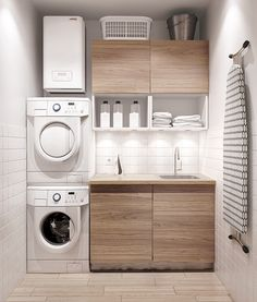 Water heater above laundry machines