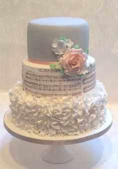 Music & Ruffles, pastel colours and a ruffle effect for the bottom tier teamed with the couple's favourite love theme around the middle tier